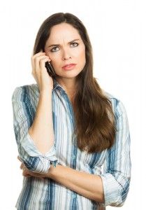 woman on hold on the phone